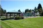 Shelterhouse, Playground, and Open Grassy Area at Bailey Park on a Clear Day